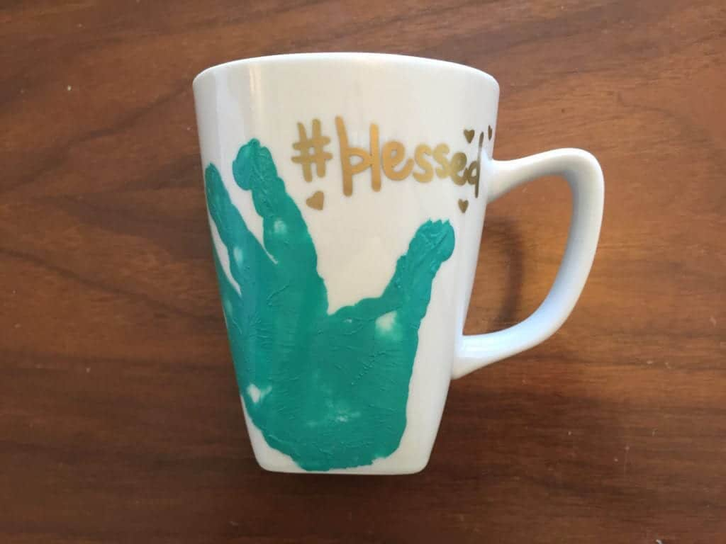 Diy handprint mug if youre not comfortable with your own hand writing you may want to practice what youre going to write on a scratch piece of paper or buy some stencils solutioingenieria Choice Image