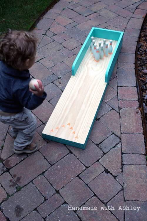 3-Do-it-Yourself-from-scrap-wood-bowling-lane-for-kids-Handmade-by-Ashley-featured-on-@Remodelaholic-533x800