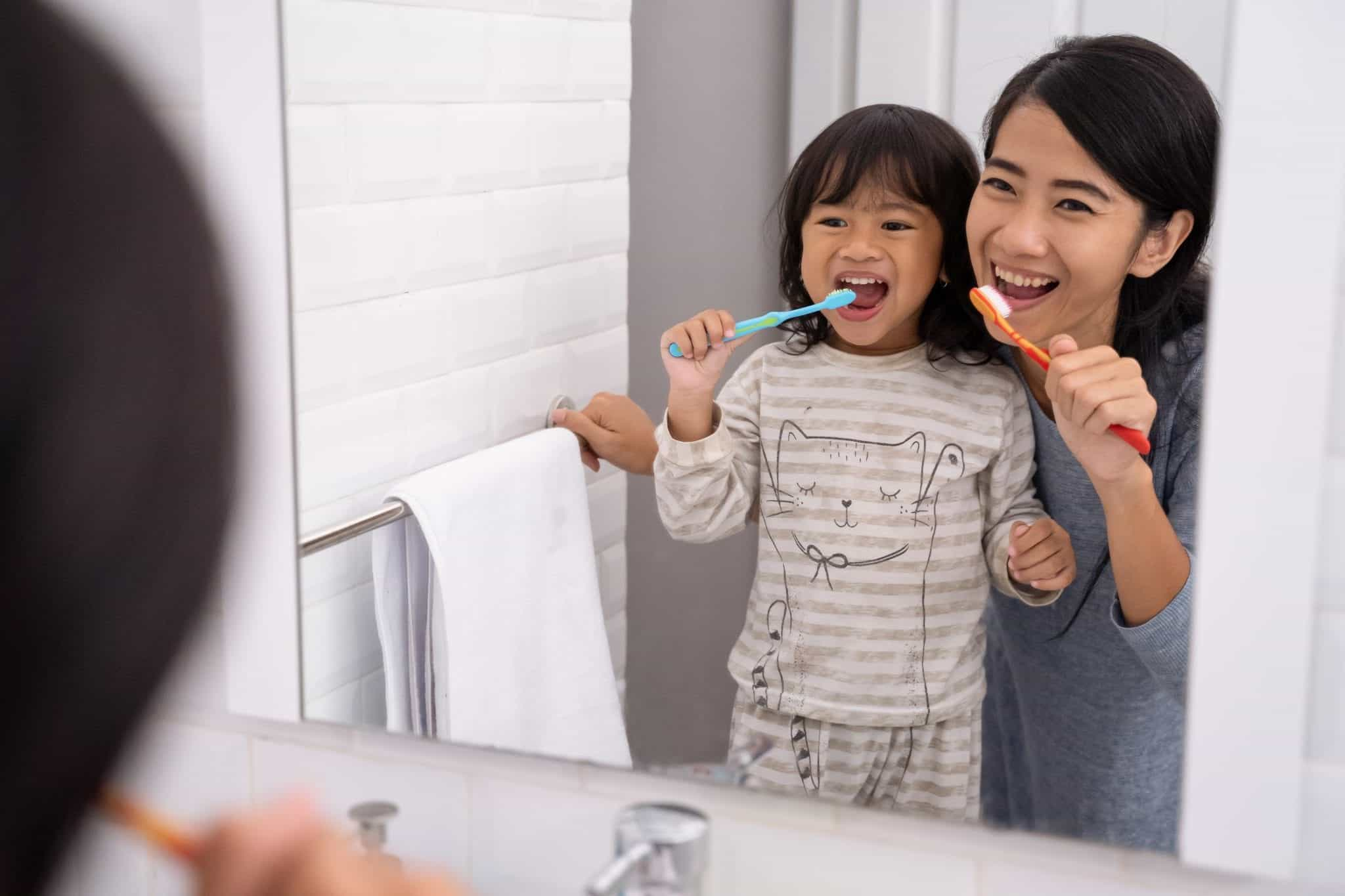 kid brushing teeth child dentist