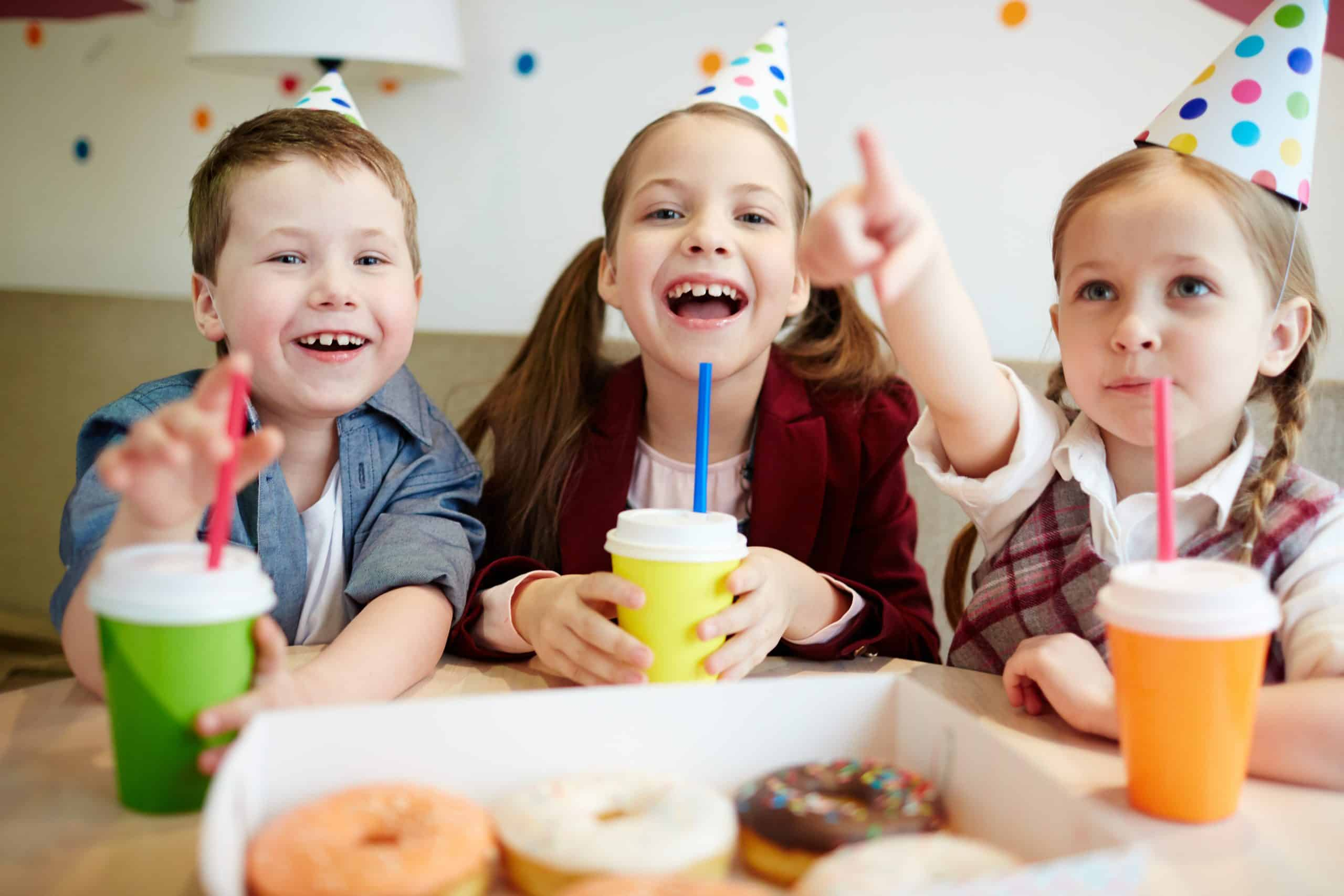 Ecstatic kids with drinks enjoying time in cafetria eat less sugar